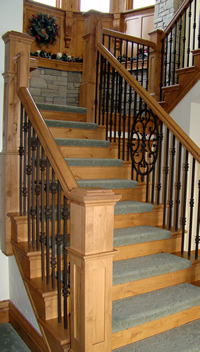 Wood staircase with iron spindles